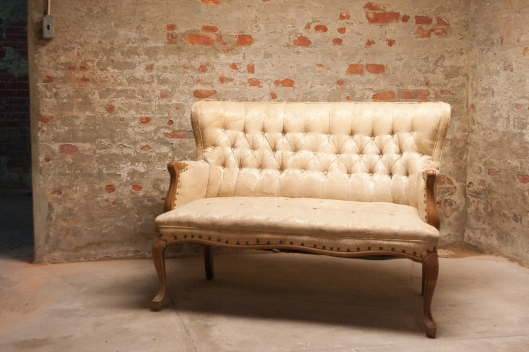 an antique sofa to sit on and view the cheese maturing
