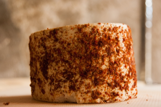cheese rubbed with dehydrated tomato and hot peppers