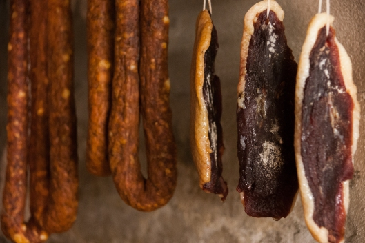 duck prosciutto, spanish style chorizo dry curing in the basement cave.